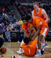 Evansville's Marty Hill's teammates pick him up after he made a steal and a slam dunk against Drake at the Ford Center Wednesday night. Hill was fouled hard on the play, but sank his free throw for the three point play. The Purple Aces beat the Bulldogs 82-77 in double overtime.