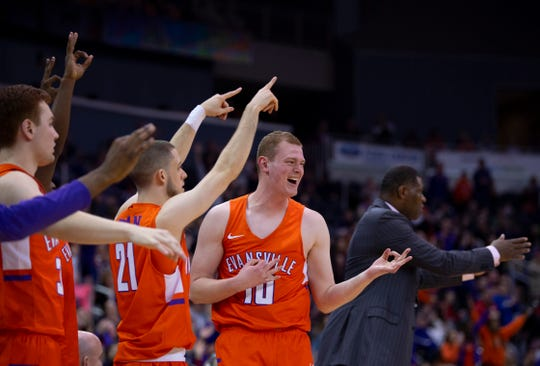 The Evansville bench celebrates a three-pointer against Drake at the Ford Center Wednesday night. The Purple Aces beat the Bulldogs 82-77 in double overtime.