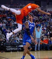 Evansville's Marty Hill falls from the rim after being fouled by Drake's Tremell Murphy at the Ford Center on Jan. 2. It came after a dunk that landed him on No. 3 of ESPN Sportscenter's Top Plays of the night.