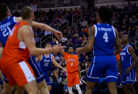 Evansville's Marty Hill (1) watches his three-pointer swish against Drake's Brady Ellingson (22) at the Ford Center Wednesday night. The Purple Aces beat the Bulldogs 82-77 in double overtime.