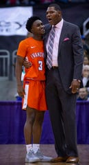 Evansville's Jawaun Newton (3) gets some advice from Head Coach Walter McCarty at the Ford Center Wednesday night. The Purple Aces beat the Bulldogs 82-77 in double overtime.