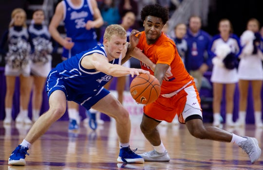 Evansville's Shamar Givance, right, nearly gets the steal against Drake's Garrett Sturtz at the Ford Center Wednesday night. The Purple Aces beat the Bulldogs 82-77 in double overtime.
