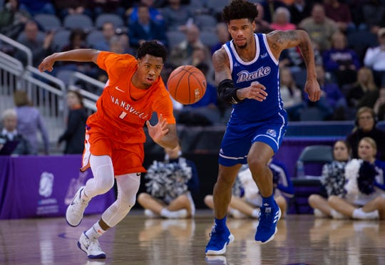 Evansville's Marty Hill (1) makes a steal against Drake's Tremell Murphy (2) at the Ford Center Wednesday night. The Purple Aces beat the Bulldogs 82-77 in double overtime.
