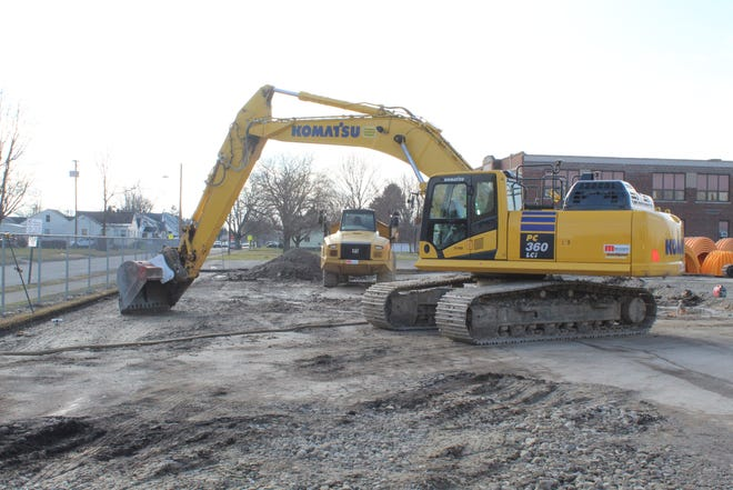 Construction continued Thursday at Croghan Elementary School on a new school building, one of four new elementary school buildings Fremont City Schools has planned for the district.