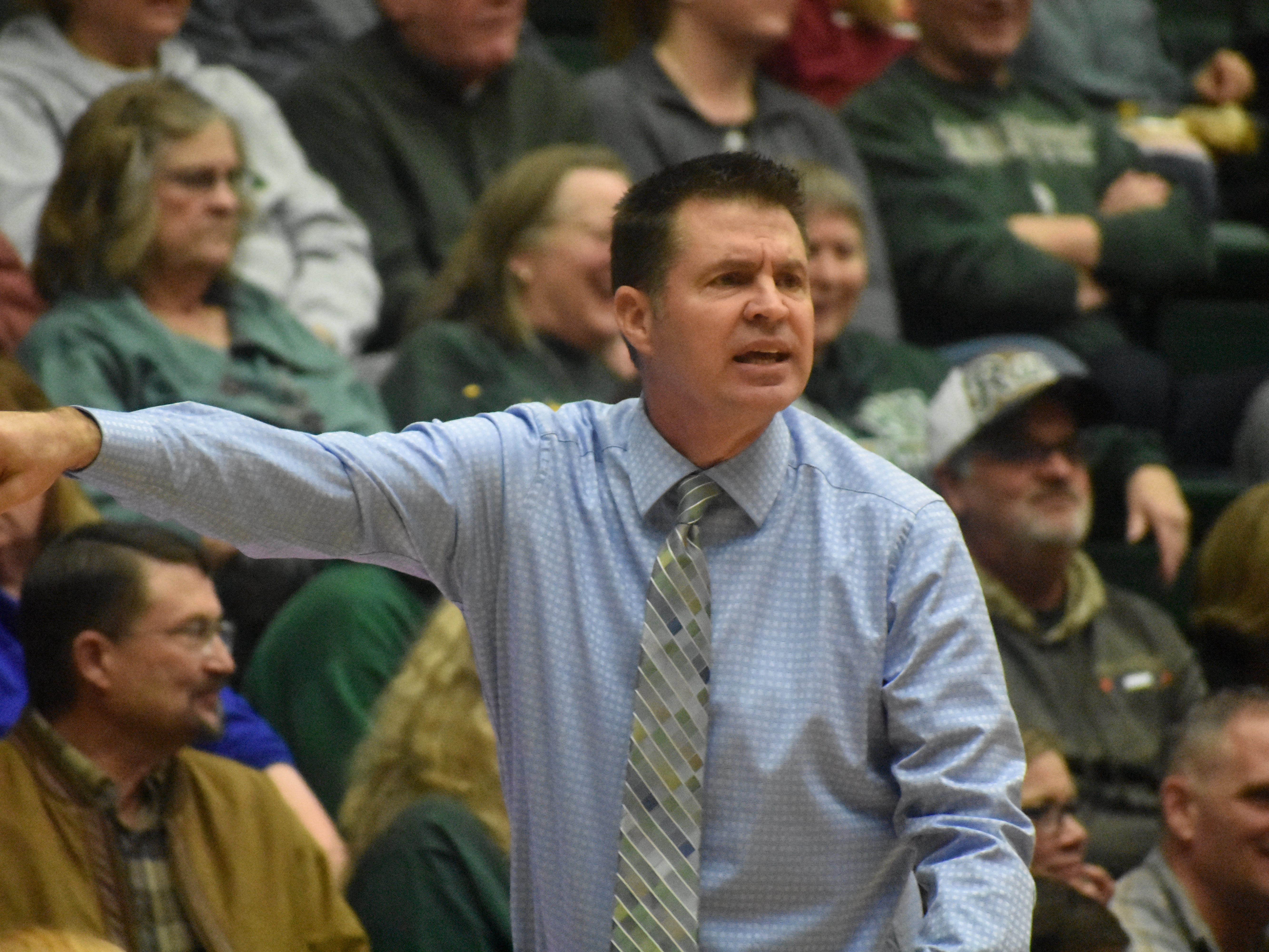 Colorado State basketball coach Ryun Williams signals to his team during Wednesday's game against UNLV at Moby Arena.