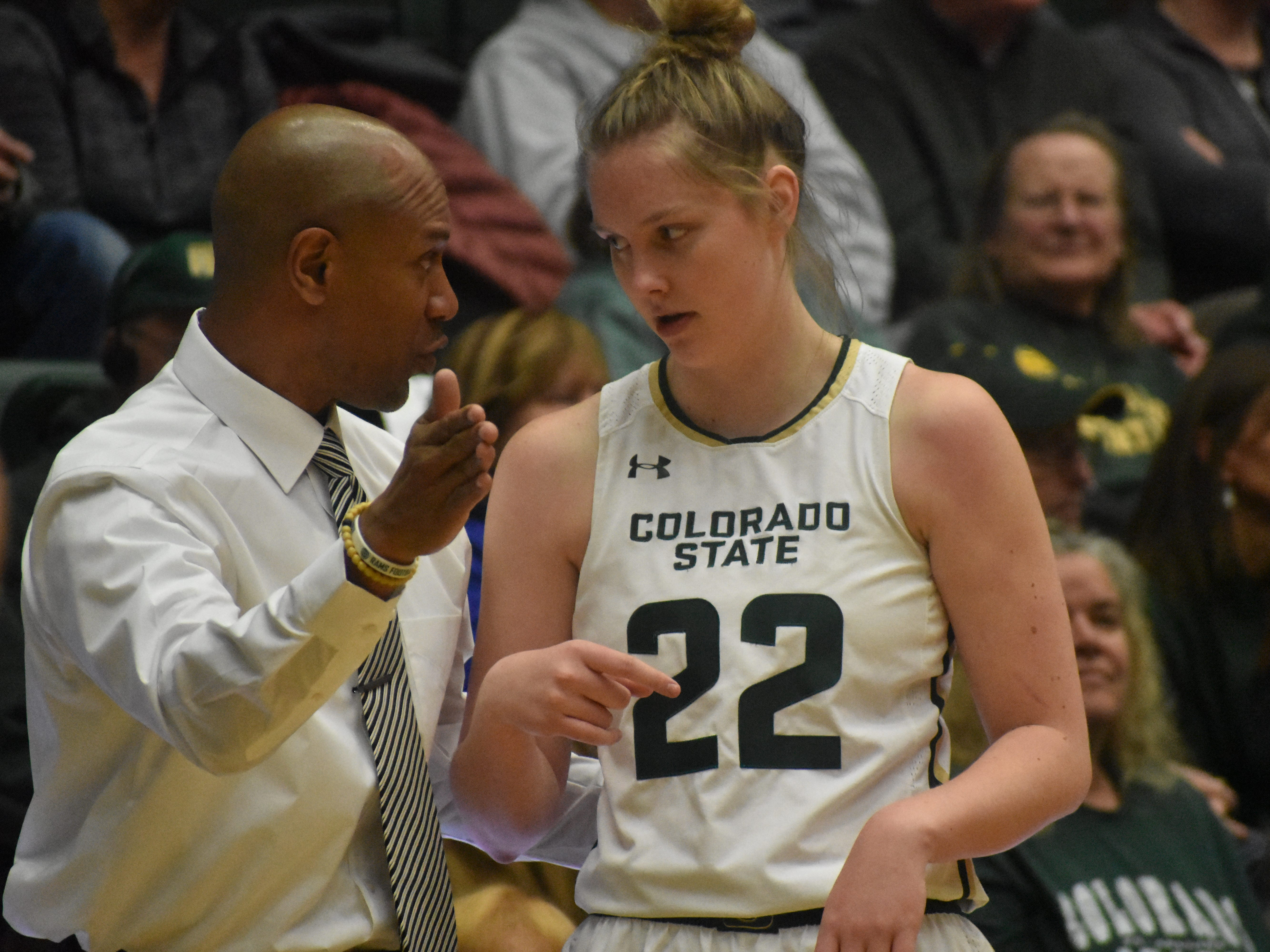 Colorado State basketball guard Lauren Brocke talks with assitant coach Rico Burkett during Wednesday's game against UNLV at Moby Arena.