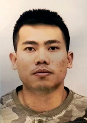 This undated photo provided by the Indianapolis Police Department shows Peter Van Bawi Lian. Authorities say the 21-year-old soldier who flew from Colorado to Indiana and allegedly killed his wife, then fled to Thailand, is now wanted for military desertion.