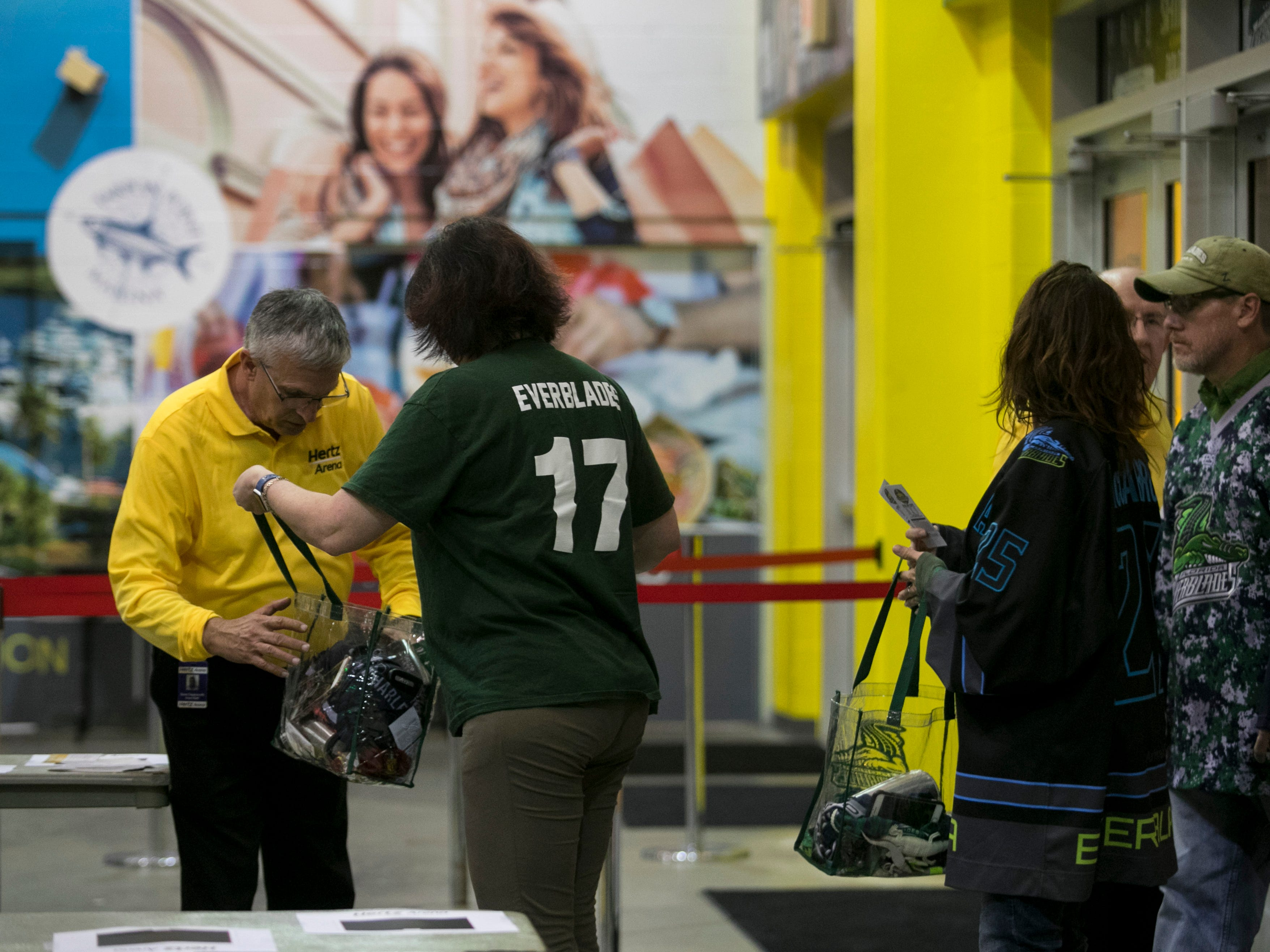 """Brigid Fahey has her bag inspected by a security guard at Hertz Arena in Estero on Wednesday, Jan. 2, 2019. A new policy went into effect Tuesday, banning large bags including purses and backpacks in the arena. Patrons can bring a clutch purse or a see-through bag. """"I'd rather be safe,"""" said Fahey about the new policy."""