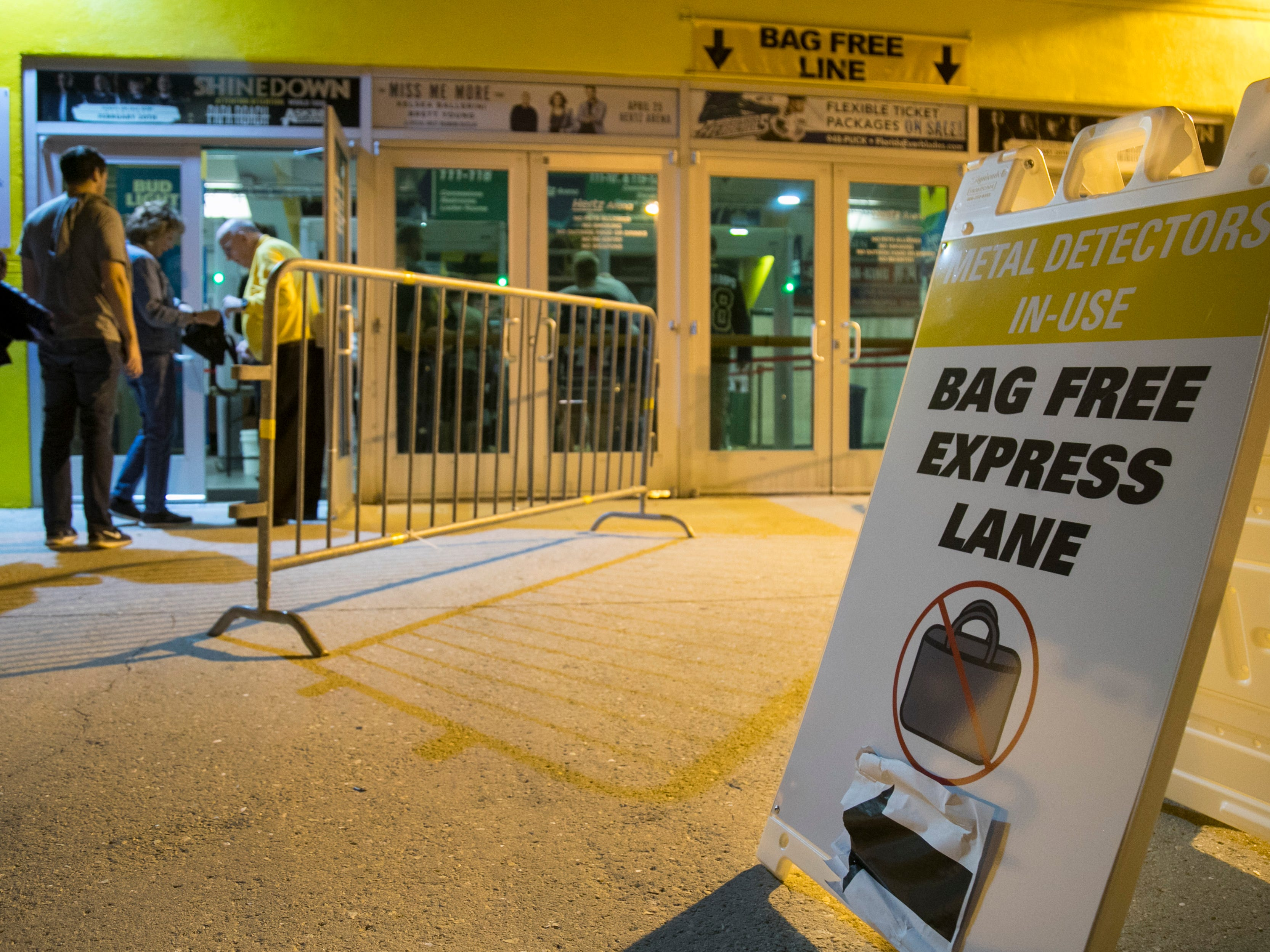 Everblades fans enter Hertz Arena in Estero on Wednesday, Jan. 2, 2019. They had bags checked and had to pass through metal detectors. Some were required to take large bags back to their vehicles.