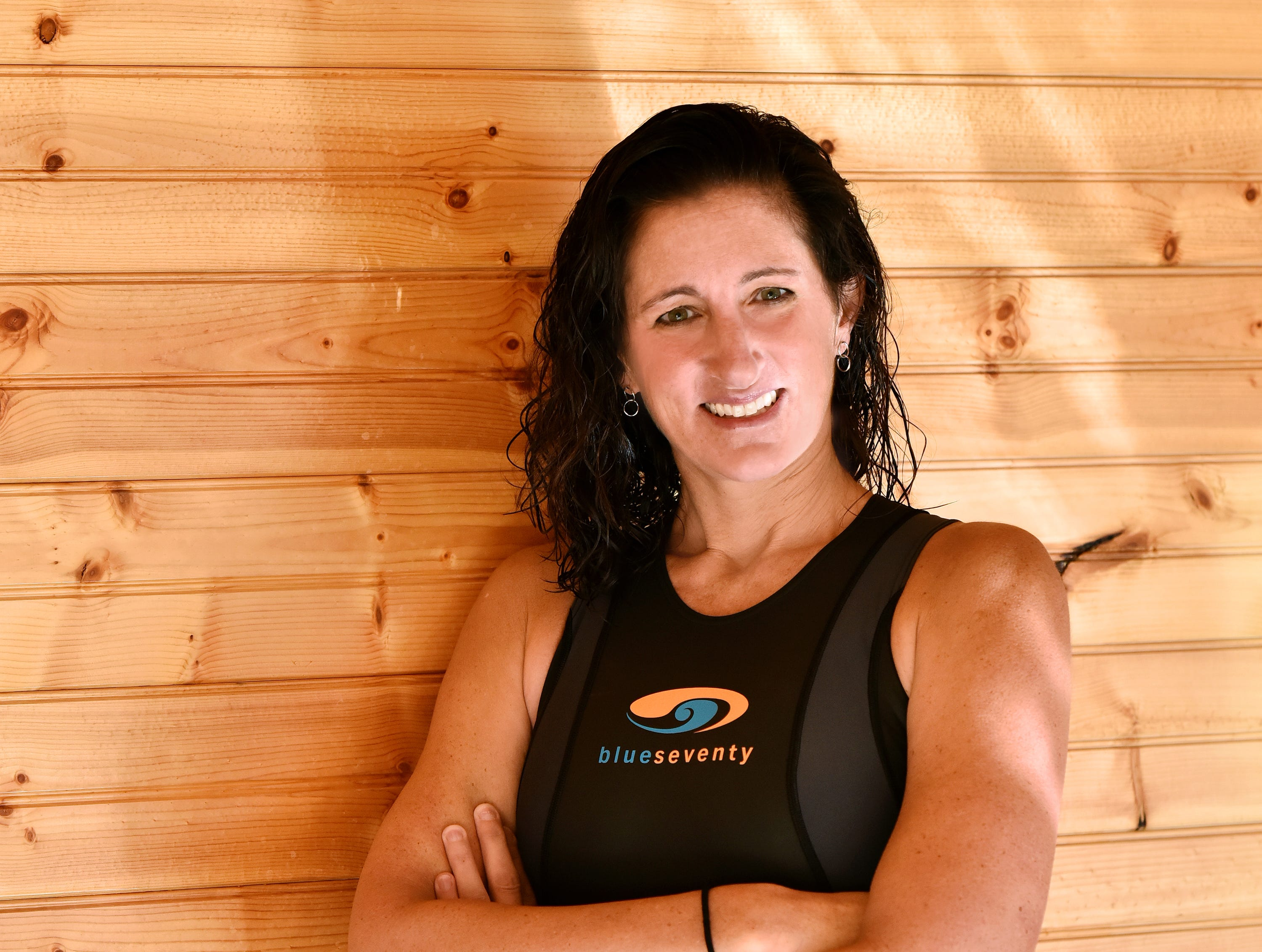 Katie Malone is a triathlete and teaches swimming in her indoor pool.
