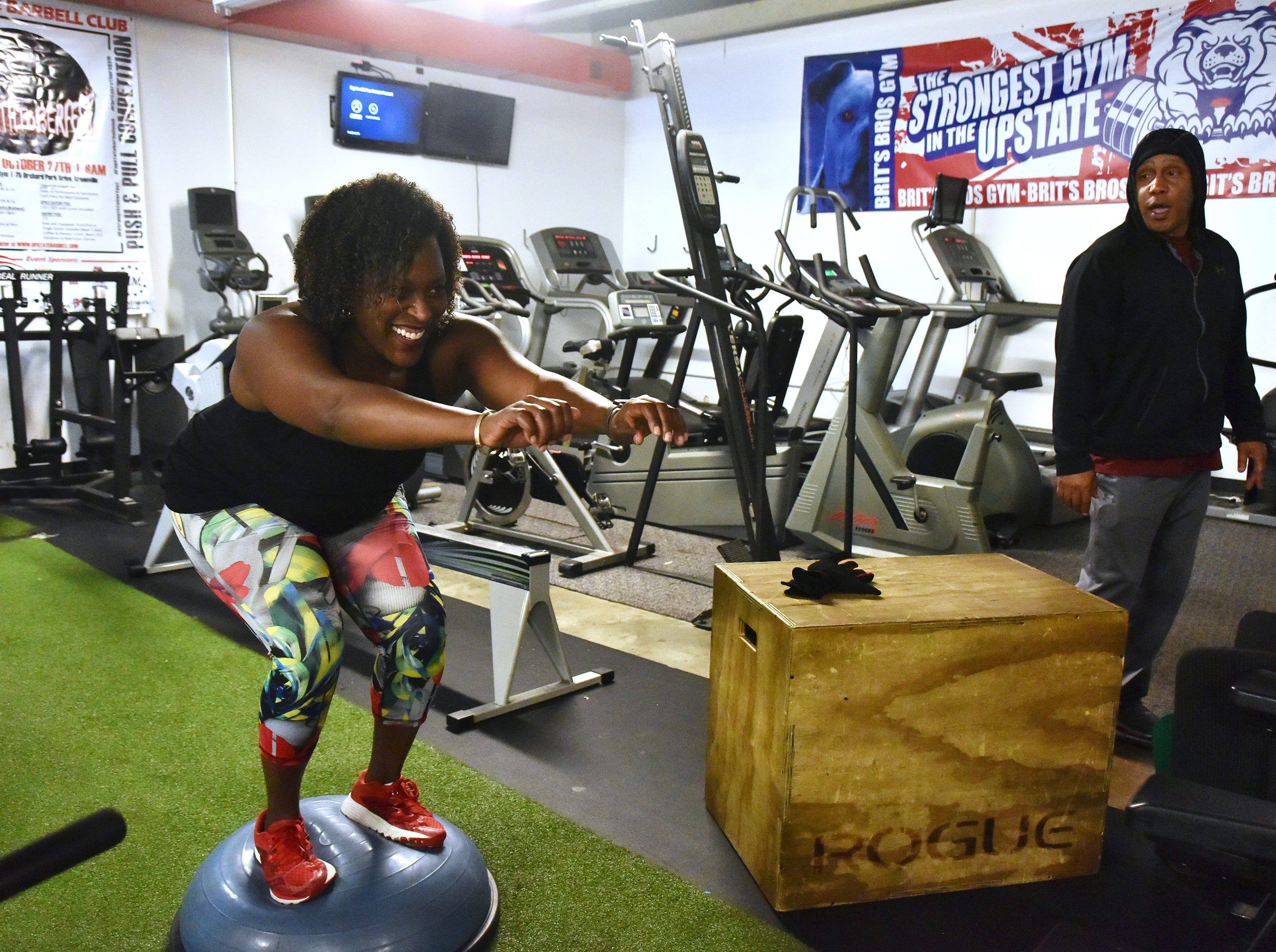 Jil Littlejohn works with strength coach Guy Mosley at Brit's Brothers Gym during a recent work out.