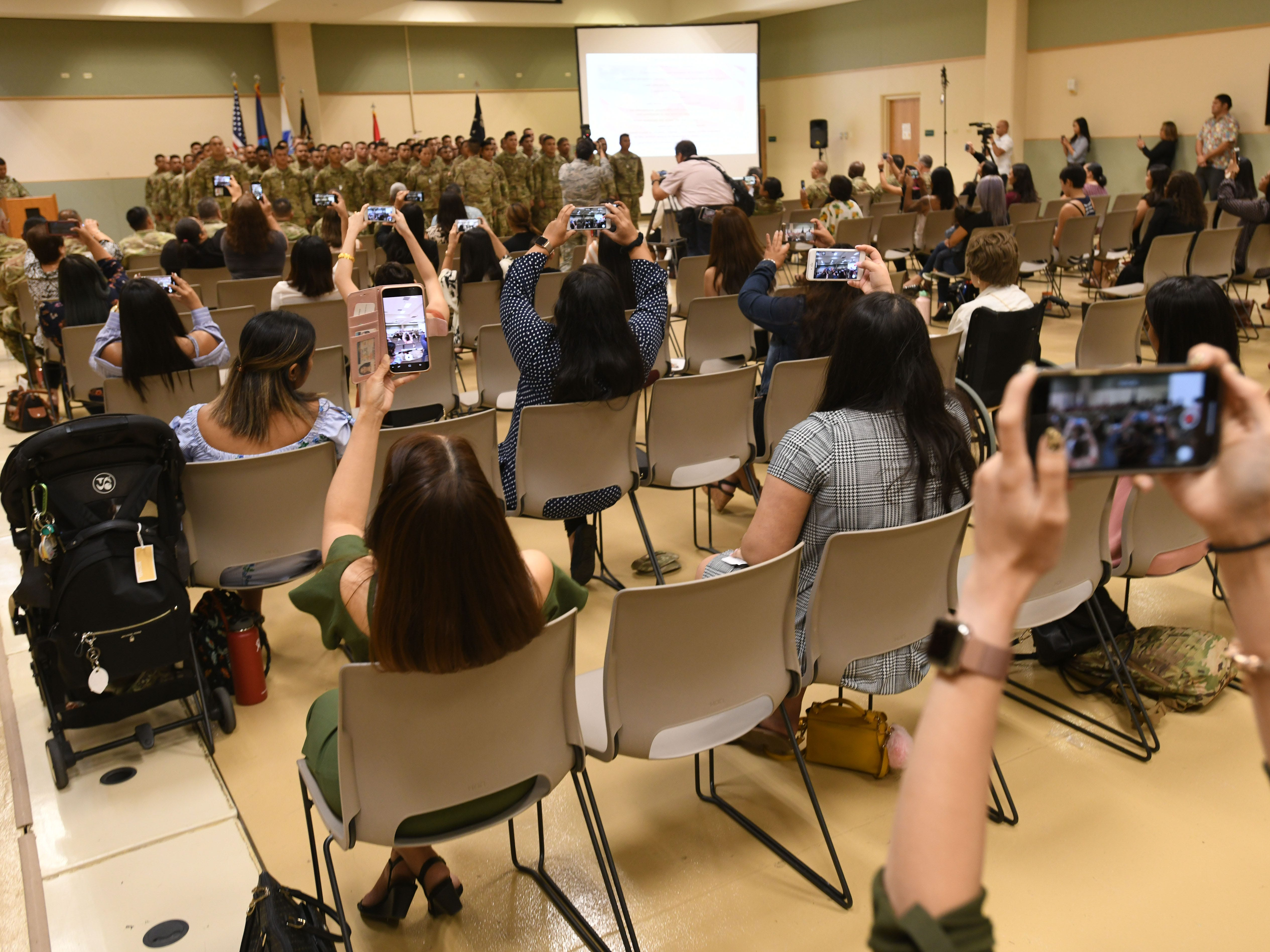 Family members and others capture images of service members reciting the Soldier's during a mobilization ceremony at the Guam National Guard compound in Barrigada on Thursday, Jan. 3, 2019. Seventy-one members with the Guam Army National Guard's 254th Security Forces 1st-294th Infantry Regiment were recognized as they begin the process of providing security for the Terminal High Altitude Area Defense Site at Andersen Air Force Base, according to a Guard release.