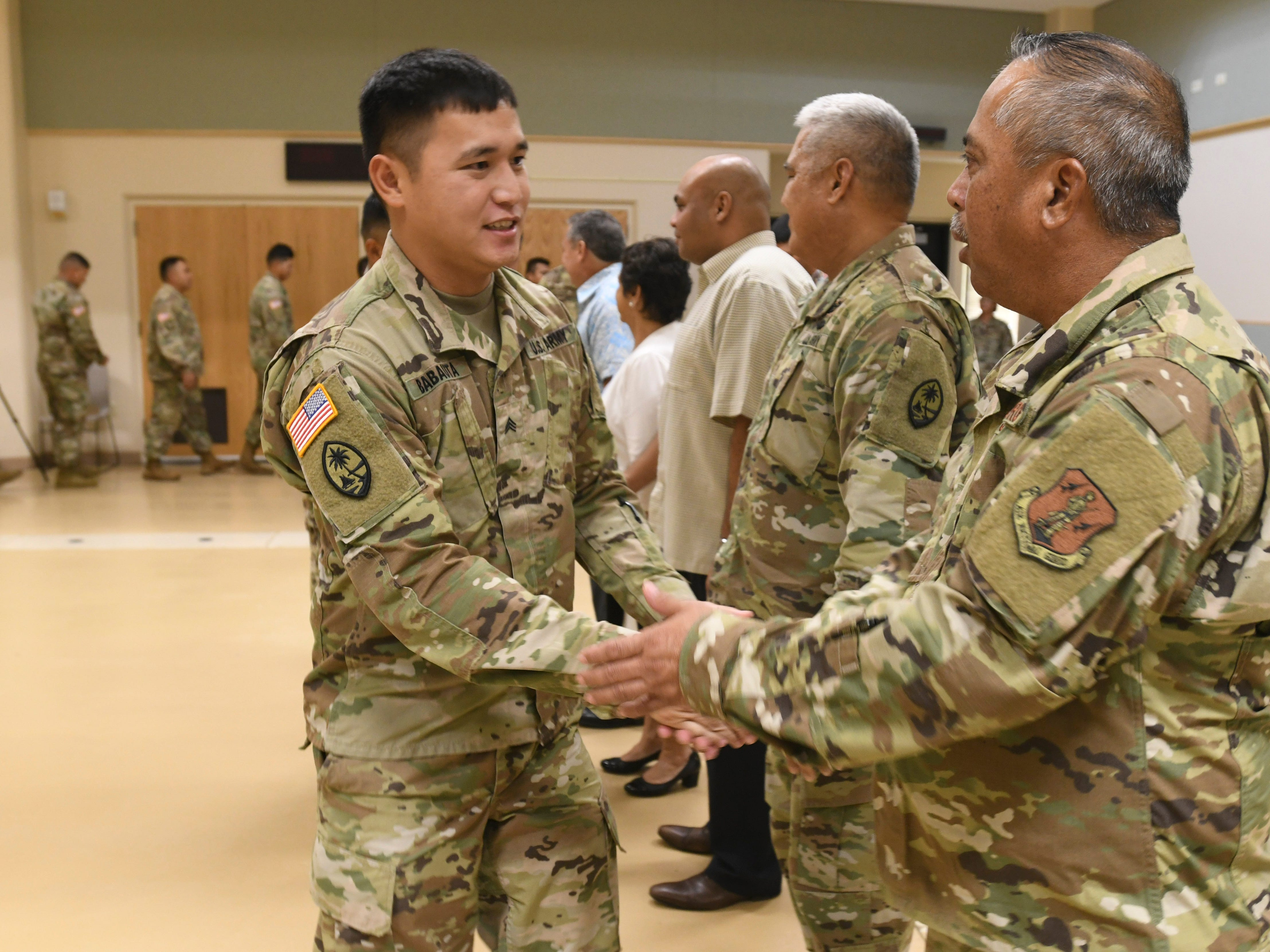 Seventy-one members with the Guam Army National Guard's 254th Security Forces 1st-294th Infantry Regiment are greeted by the official party during a mobilization ceremony held at the Guam National Guard compound in Barrigada on Thursday, Jan. 3, 2019. Family, friends and other supporters attended the event with the soldiers as they prepare to undertake a yearlong mission to provide security for the Terminal High Altitude Area Defense Site at Andersen Air Force Base, according to a Guard release.