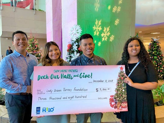 """IT&E helped the Guam International Airport """"Deck it's halls"""" to raise funds for the First Lady Diann Torres Foundation. Pictured from left: Danny Daniel, senior manager of brand and public relations of IT&E; Kristina Tajalle, marketing coordinator of IT&E; Donovan Tudela, representative of the Lady Diann Torres Foundation; and Joy White, content specialist of IT&E."""