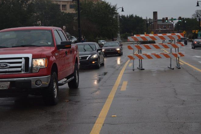 Vehicles drive past a barricade in the rain on Thursday, Jan. 3, 2019, on Hardy Street in Hattiesburg.