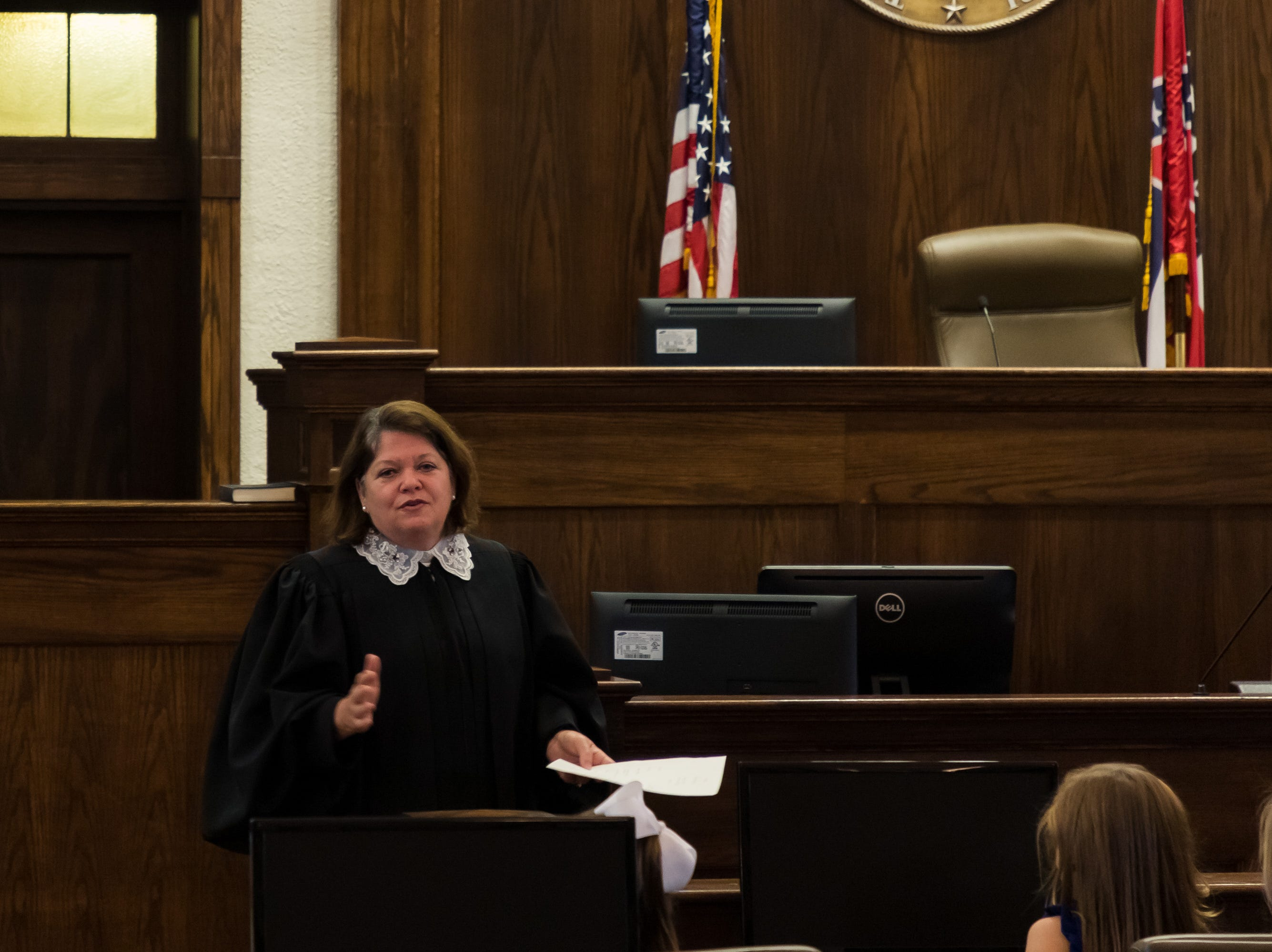 Mississippi Supreme Court Justice Dawn Beam welcomes the assembled crowd to Brad Touchstone's investiture ceremony at Lamar County Courthouse in Purvis on Wednesday, Jan. 2, 2019.