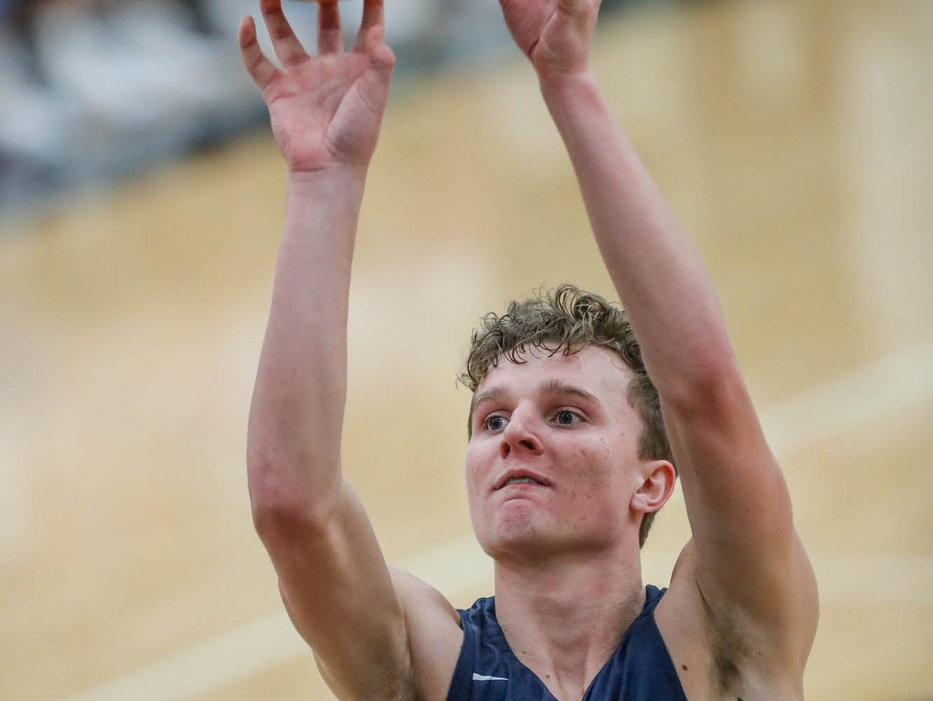 Plainfield High School's forward Cade East (10) shoots a free throw during a 2019 Hendricks County Basketball Tournament game between Plainfield High School and Cascade High School, held at Cascade on Wednesday, Jan. 2, 2019.