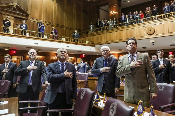 Members of the Indiana House of Representatives stand for the Pledge of Allegiance on the starting day of legislative session at the Indiana Statehouse, Indianapolis, Thursday, Jan. 3, 2019.