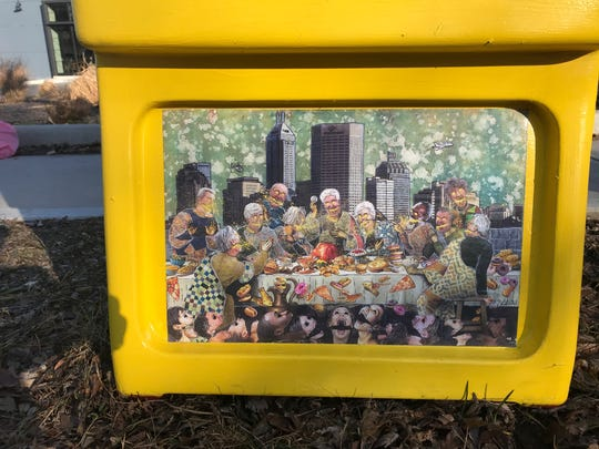 This old newspaper box now serves as a small food pantry on East 10th Street, near the popular restaurant Beholder. The box includes work by local artist Michelle Johnson and a series of quotes about the negative effects of gentrification.