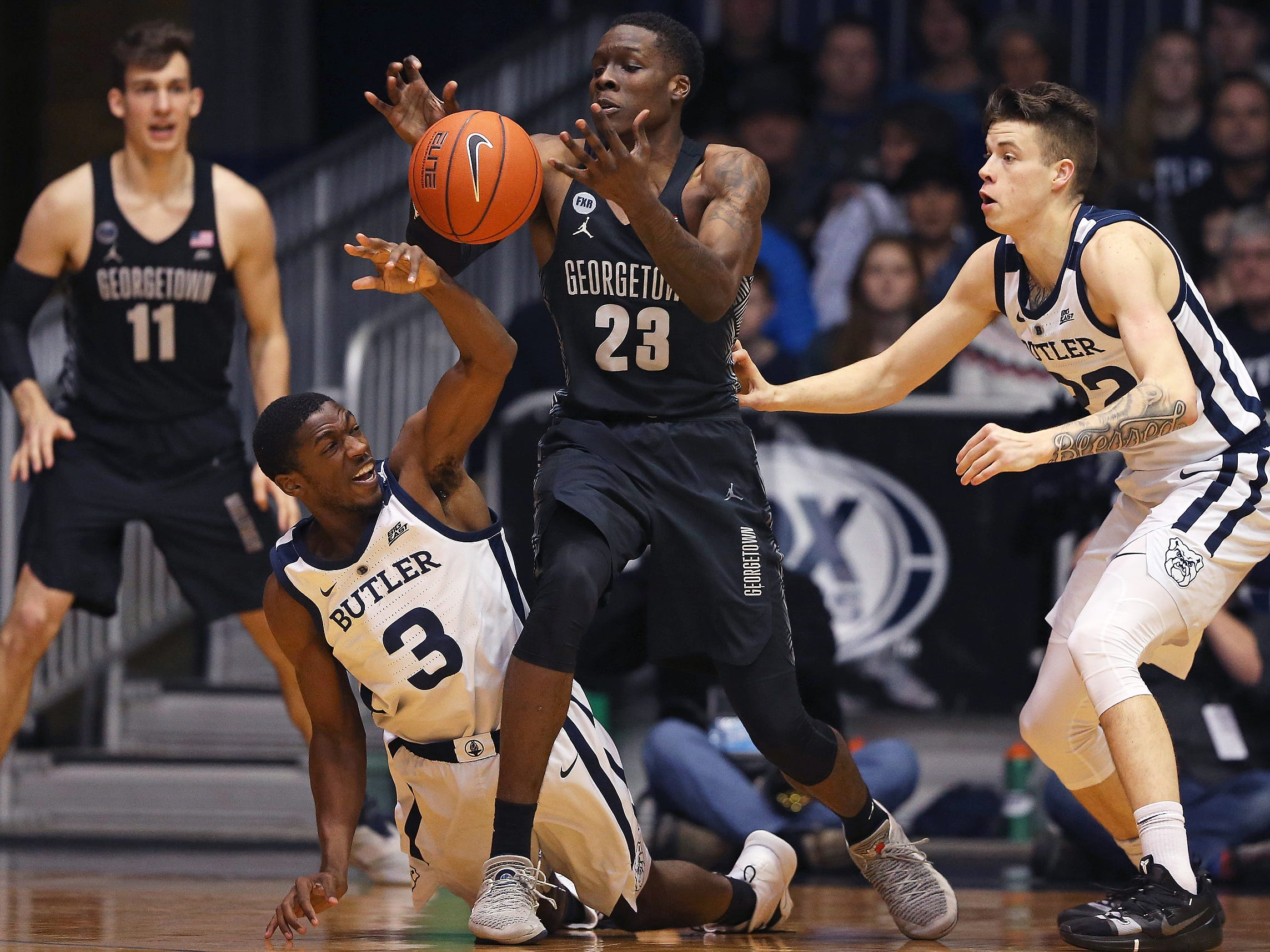 Georgetown Hoyas forward Josh LeBlanc (23) tries to recover a loose ball against Butler Bulldogs guard Kamar Baldwin (3) during the first half of game action between Butler University and Georgetown University, at Hinkle Fieldhouse in Indianapolis, Indiana on Wednesday, Jan. 2, 2019.