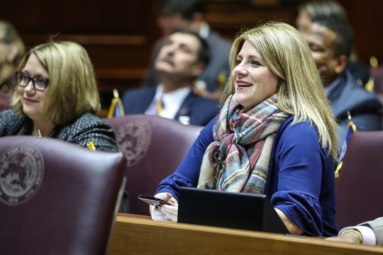 Rep. Melanie Wright listens to speakers on the starting day of legislative session at the Indiana Statehouse, Indianapolis, Thursday, Jan. 3, 2019.