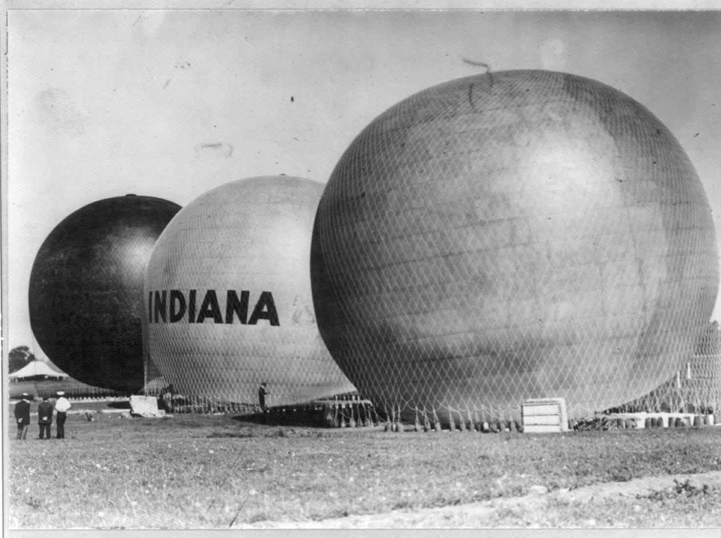 Balloons: Chicago, Indiana, and Hoosier netted down to ground prior to the  National Balloon Race in 1909 starting at the Indianapolis Motor Speedway.