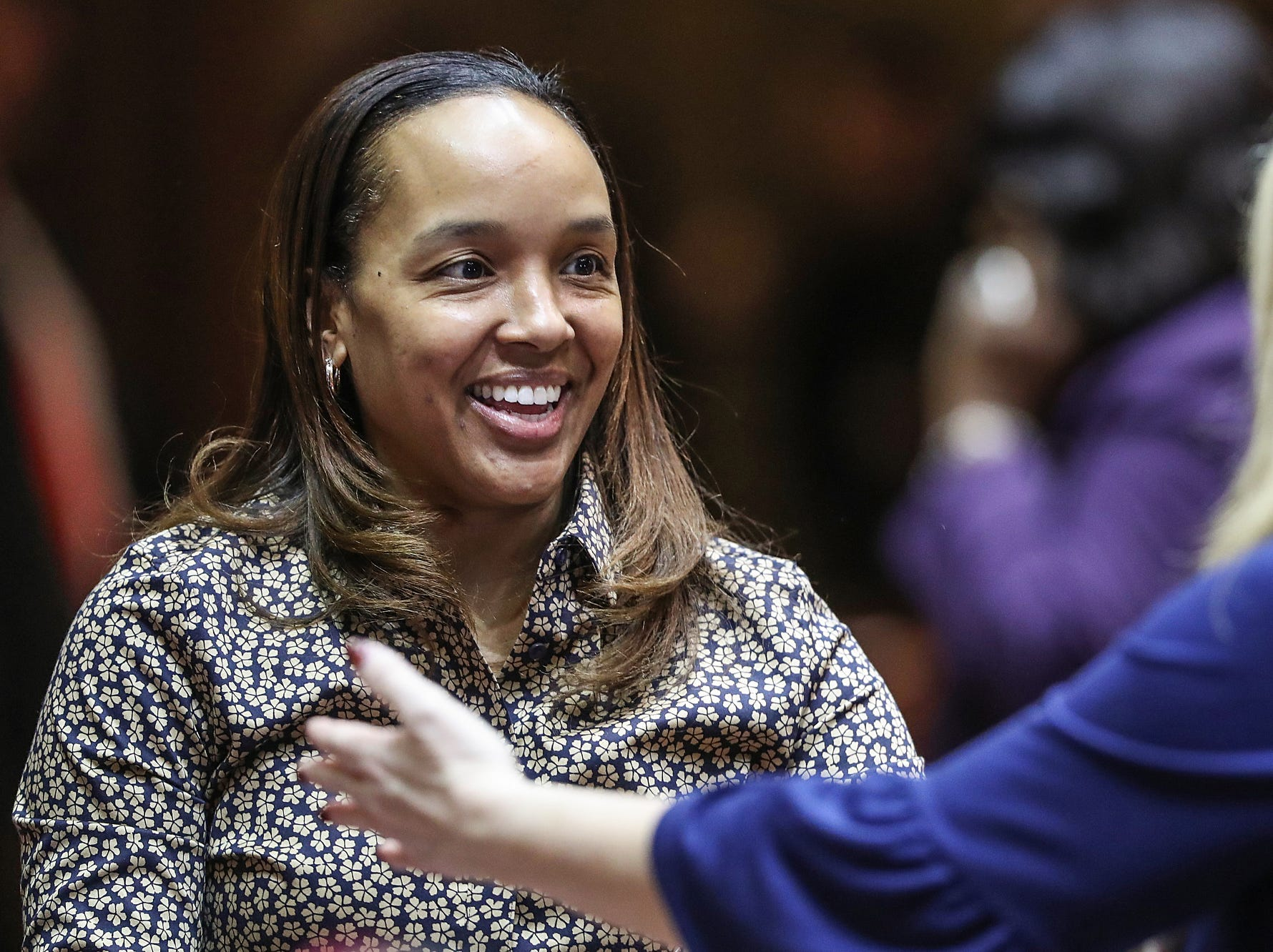 Rep. Ragen Hatcher is greeted by a colleague on the starting day of legislative session at the Indiana Statehouse, Indianapolis, Thursday, Jan. 3, 2019.