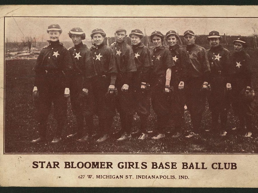 "Star Bloomer girls base ball club 627 W. Michigan St. Indianapolis, Ind. circa 1905.   ""Bloomer Girls"" took to the field on barnstorming tours. They werenÕt in a league, and teams didnÕt play each other, but rather challenged semi-pro men's teams such as the Indianapolis Reserves, Indianapolis Grays and amateur company teams. The teams were considered a novelty act and in some instances had men dressed as women."