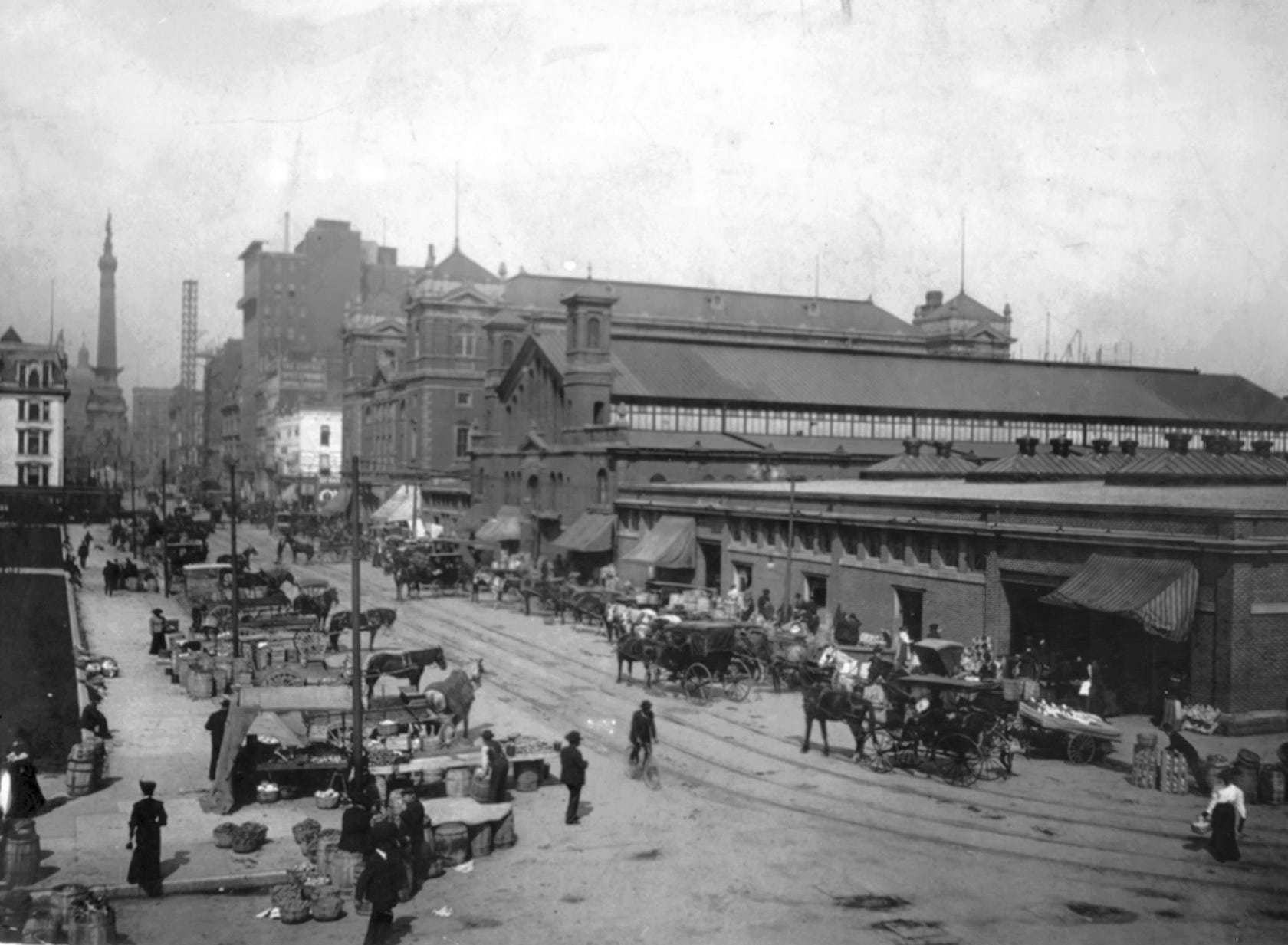 City Market in view looking northwest on Market Street (from Alabama) circa 1906. Farmers and their horse and wagons peddle produce from the street.