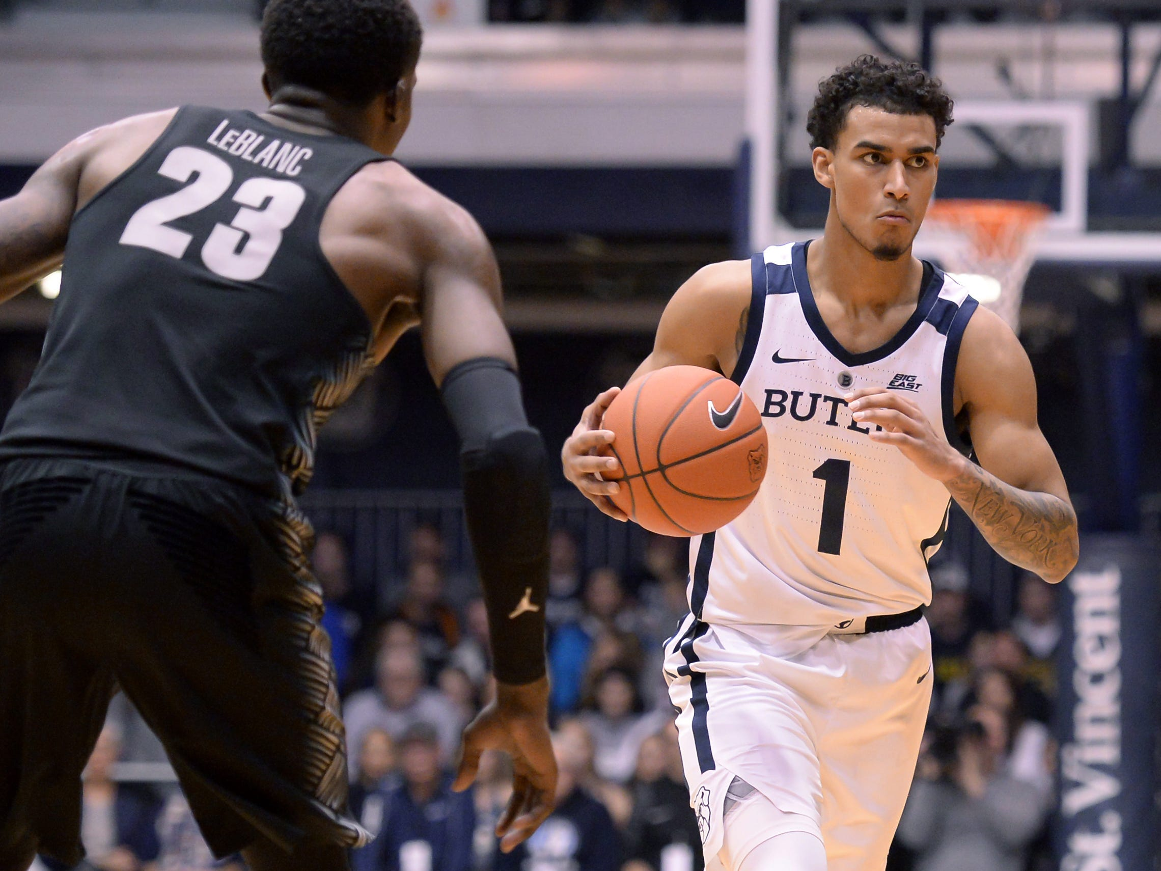 Butler Bulldogs forward Jordan Tucker (1) carries the ball against Georgetown Hoyas forward Josh LeBlanc (23) during the first half of game action between Butler University and Georgetown University, at Hinkle Fieldhouse in Indianapolis, Indiana on Wednesday, Jan. 2, 2019. The Butler Bulldogs fell to the Georgetown Hoyas 84-76.