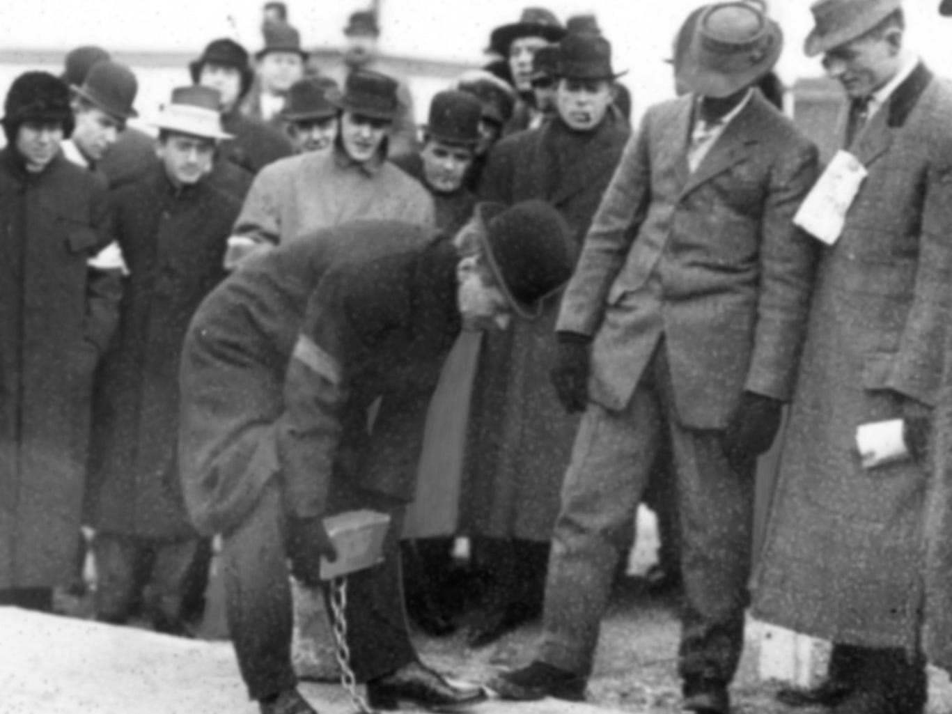 The rededication ceremony of the Indianapolis Motor Speedway Dec 17, 1909. A silver gold-plated brick was chained and cemented in its place at the start finish line in front of the judges stand. Gov. Thomas R. Marshall had the honor of placing the brick in place.