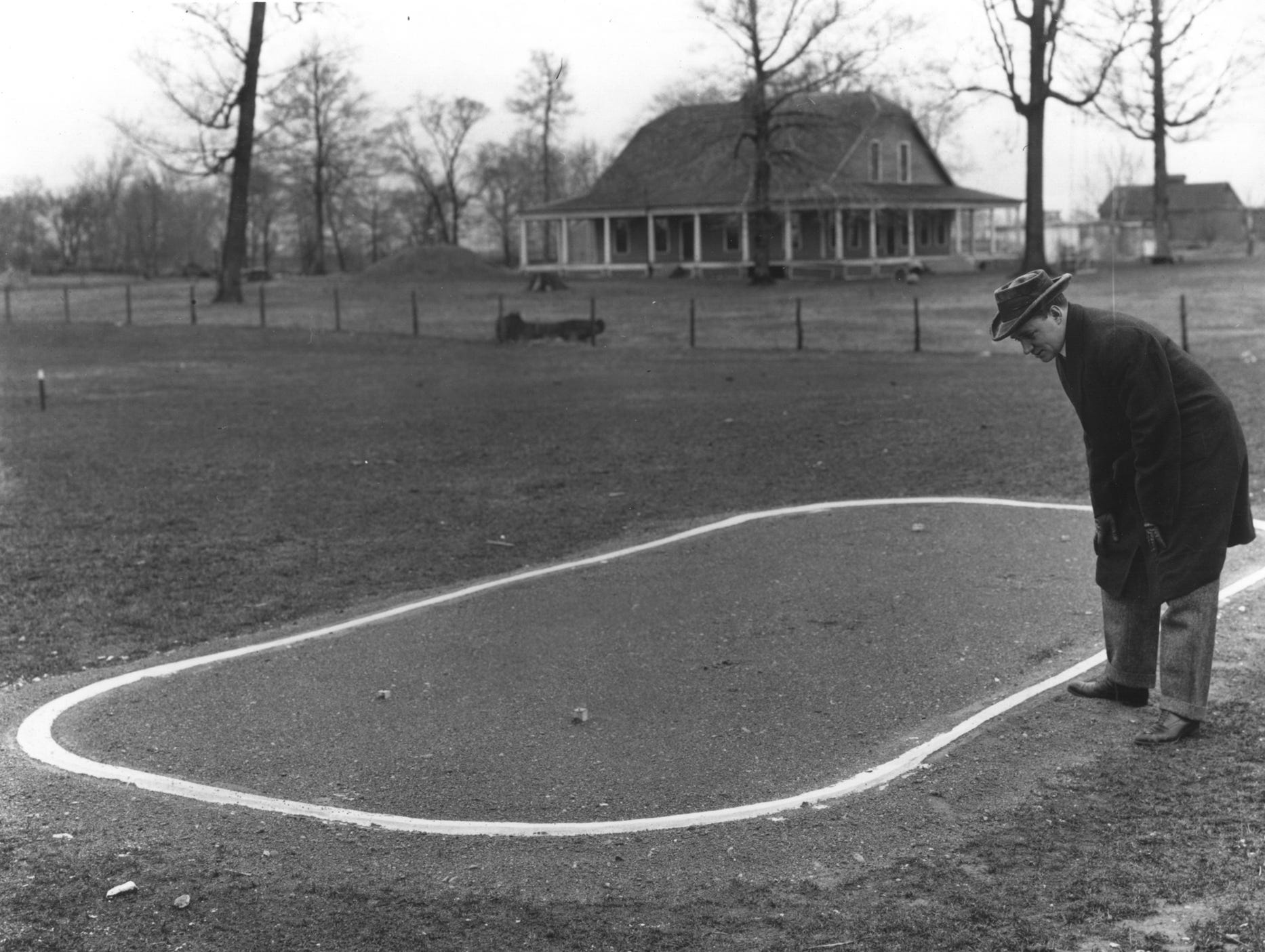 Lewis Strang surveys the 1909 layout of the Indianapolis Motor Speedway. Strang became the first entrant in the Indianapolis 500 on Oct. 22, 1910, which was significant because that determined the starting lineup for the inaugural race.