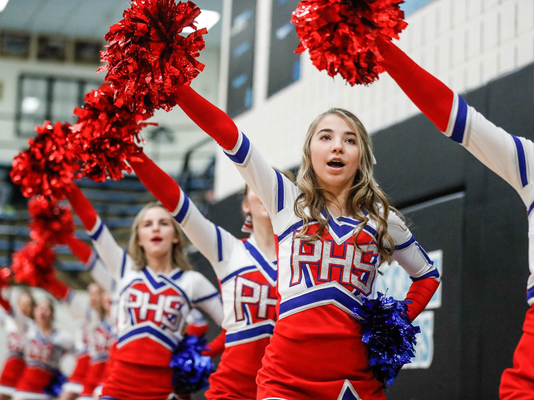 Plainfield High School Cheerleaders cheer on their team during a 2019 Hendricks County Basketball Tournament game between Plainfield High School and Cascade High School, held at Cascade on Wednesday, Jan. 2, 2019.