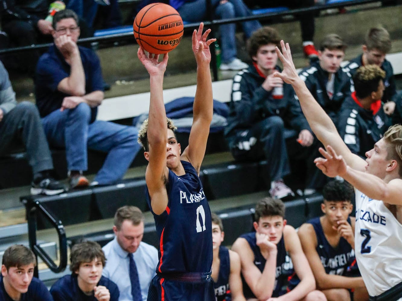 Plainfield High School's forward Cade Gibbs (11), shoots over Cascade High School's A.J. Sanders (2), during a 2019 Hendricks County Basketball Tournament game between Plainfield High School and Cascade High School, held at Cascade on Wednesday, Jan. 2, 2019.