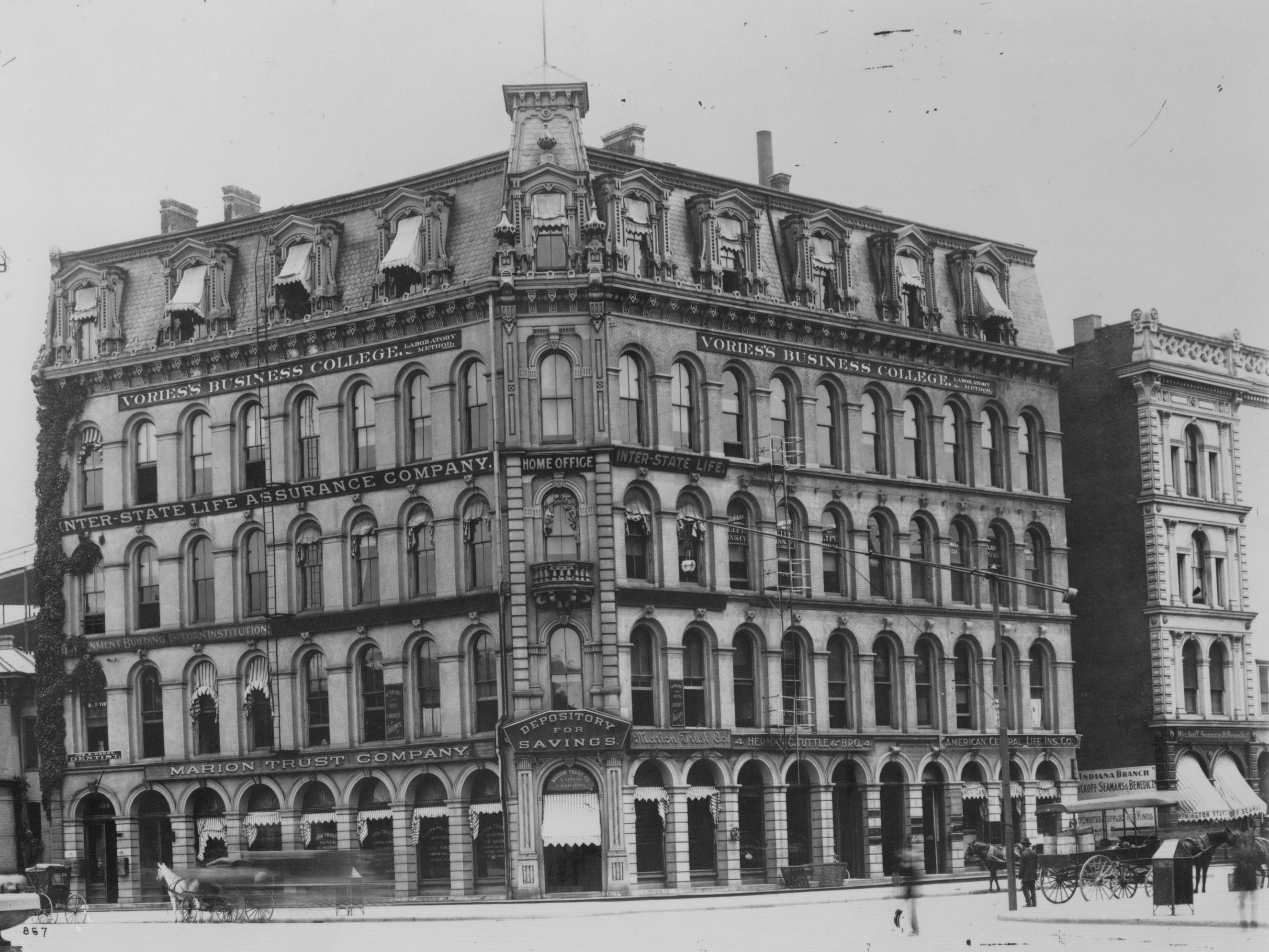 This 1903 photo shows the building at the corner of Market on the northeast quadrant of Monument Circle housed Vories's Business College, Inter State Life Assurance Company and Marion Trust Company.