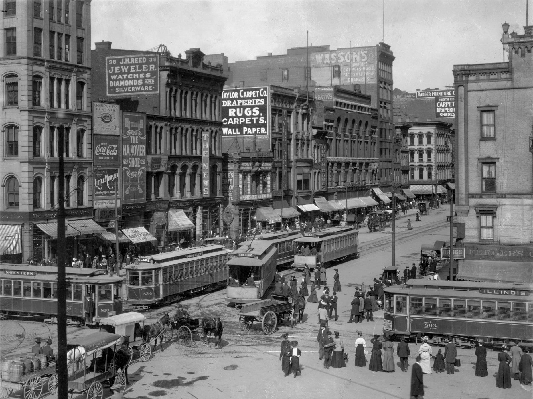 Downtown Indianapolis in 1906 at Illinois and Washington Streets looking east was a confluence of pedestrians, horse and buggy and trolleys.