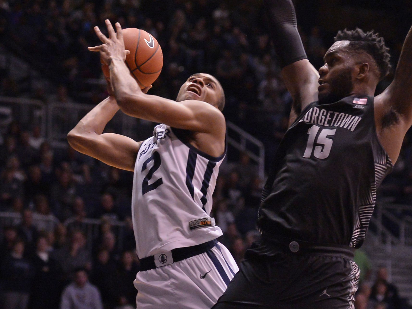 Butler Bulldogs guard Aaron Thompson (2) scores over Georgetown Hoyas center Jessie Govan (15) during the second half of game action between Butler University and Georgetown University, at Hinkle Fieldhouse in Indianapolis, Indiana on Wednesday, Jan. 2, 2019. The Butler Bulldogs fell to the Georgetown Hoyas 84-76.