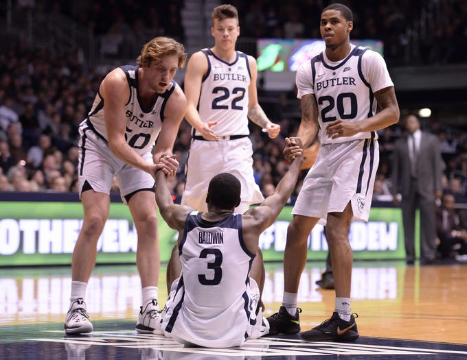 Butler Bulldogs guard Kamar Baldwin (3) is helped up by his teammates after a hard fall during the second half of game action between Butler University and Georgetown University, at Hinkle Fieldhouse in Indianapolis, Indiana on Wednesday, Jan. 2, 2019. The Butler Bulldogs fell to the Georgetown Hoyas 84-76.