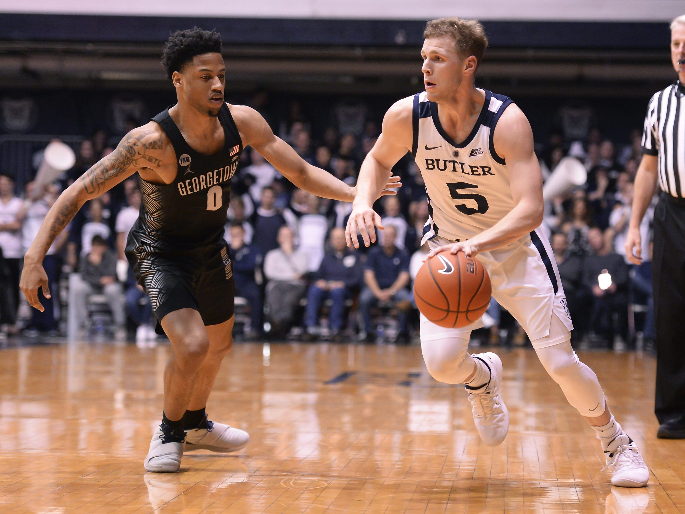 Butler Bulldogs guard Paul Jorgensen (5) carries the ball against Georgetown Hoyas guard Jahvon Blair (0) during the second half of game action between Butler University and Georgetown University, at Hinkle Fieldhouse in Indianapolis, Indiana on Wednesday, Jan. 2, 2019. The Butler Bulldogs fell to the Georgetown Hoyas 84-76.