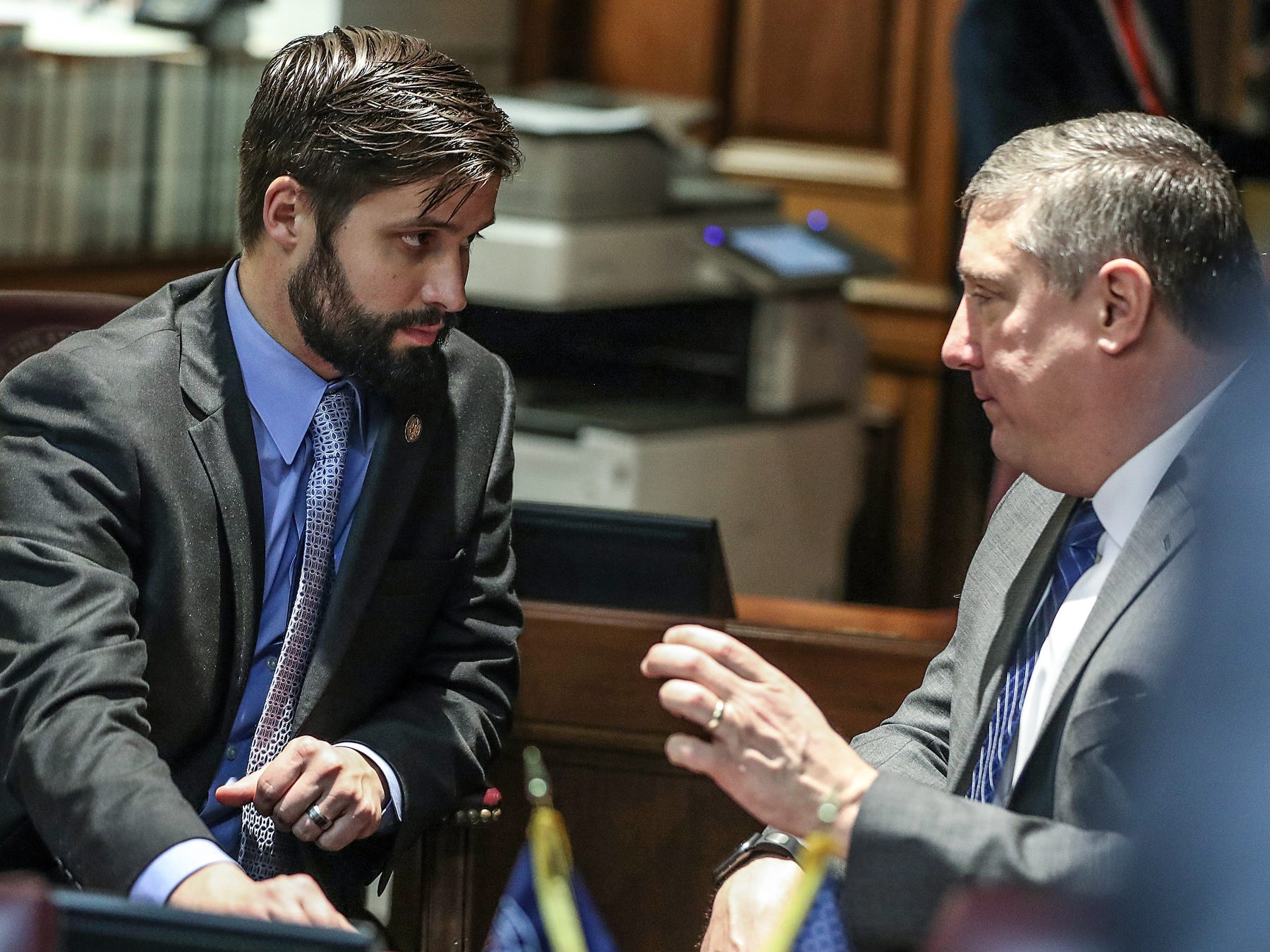 From left, Rep. Matt Hostettler talks with Rep. Ben Smaltz on the starting day of legislative session at the Indiana Statehouse, Indianapolis, Thursday, Jan. 3, 2019.