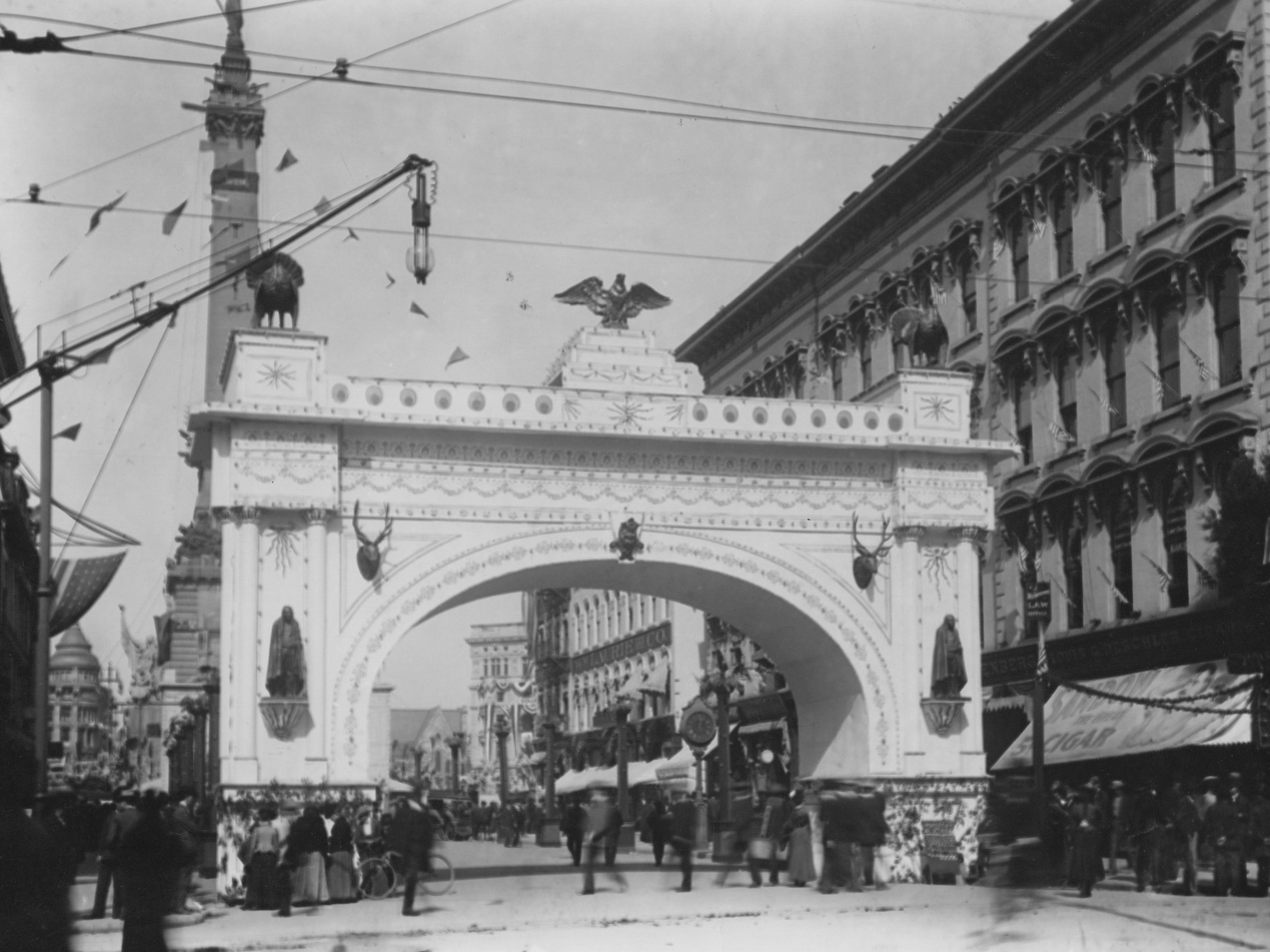 The Carnival arch on the south side of Monument Circle was erected in October 1899 in preparation for the festivities surrounding the turn of the century.