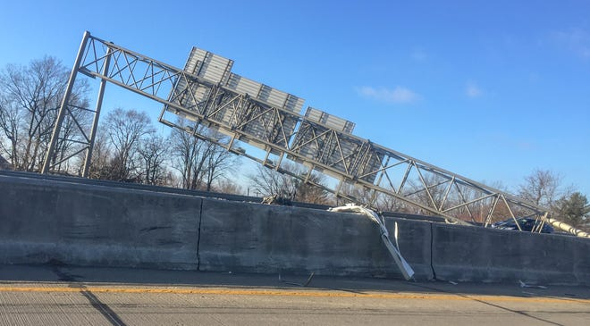 Southbound I-65 in Indianapolis is closed after a truck hit a bridge and spilled its load on Thursday, Jan. 3, 2019.