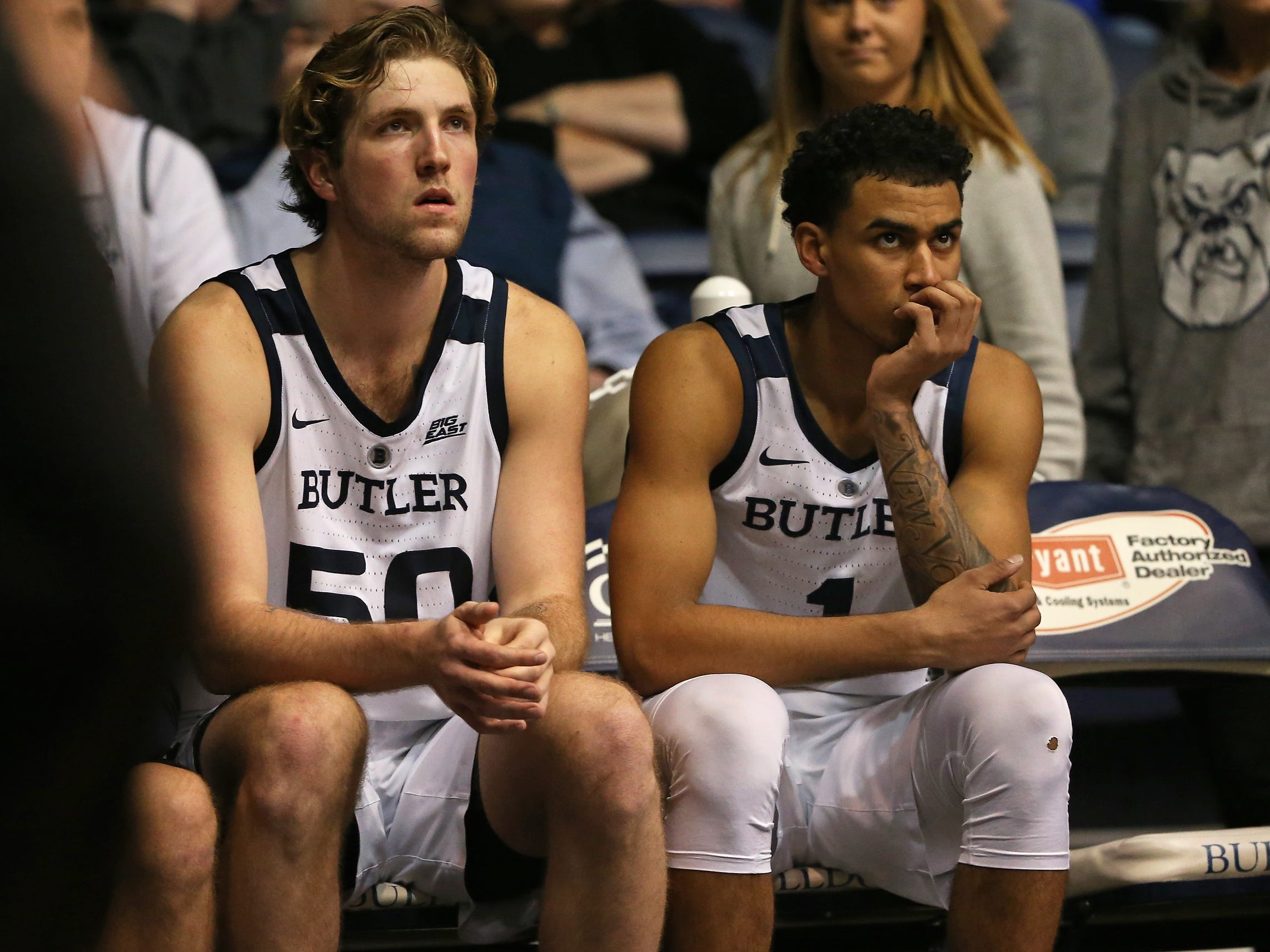 Butler Bulldogs forward Joey Brunk (50) and forward Jordan Tucker (1) watch the remaining minute of the second half of game action between Butler University and Georgetown University, at Hinkle Fieldhouse in Indianapolis, Indiana on Wednesday, Jan. 2, 2019. The Butler Bulldogs fell to the Georgetown Hoyas 84-76.