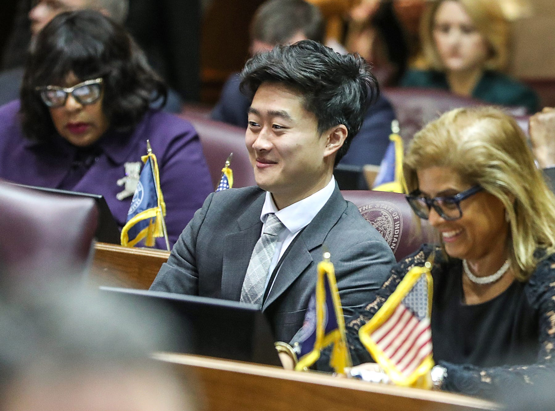 Center, Rep. Chris Chyung listens to introductions on the starting day of legislative session at the Indiana Statehouse, Indianapolis, Thursday, Jan. 3, 2019.