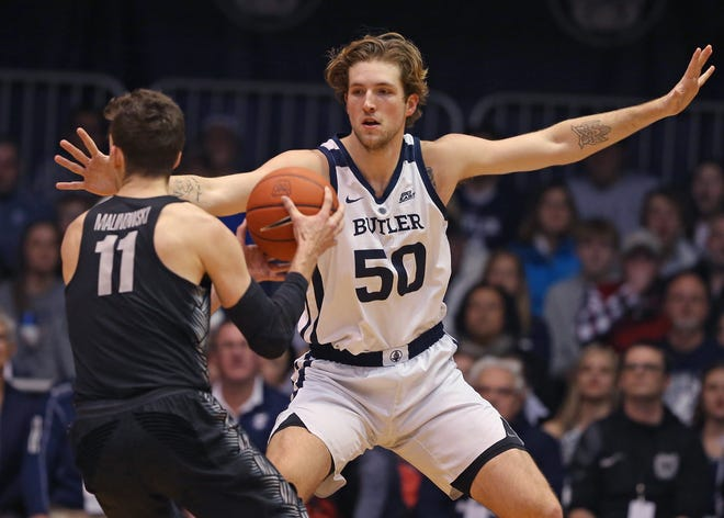 Butler Bulldogs forward Joey Brunk (50) guards Georgetown Hoyas guard Greg Malinowski (11) during the first half of game action between Butler University and Georgetown University, at Hinkle Fieldhouse in Indianapolis, Indiana on Wednesday, Jan. 2, 2019.