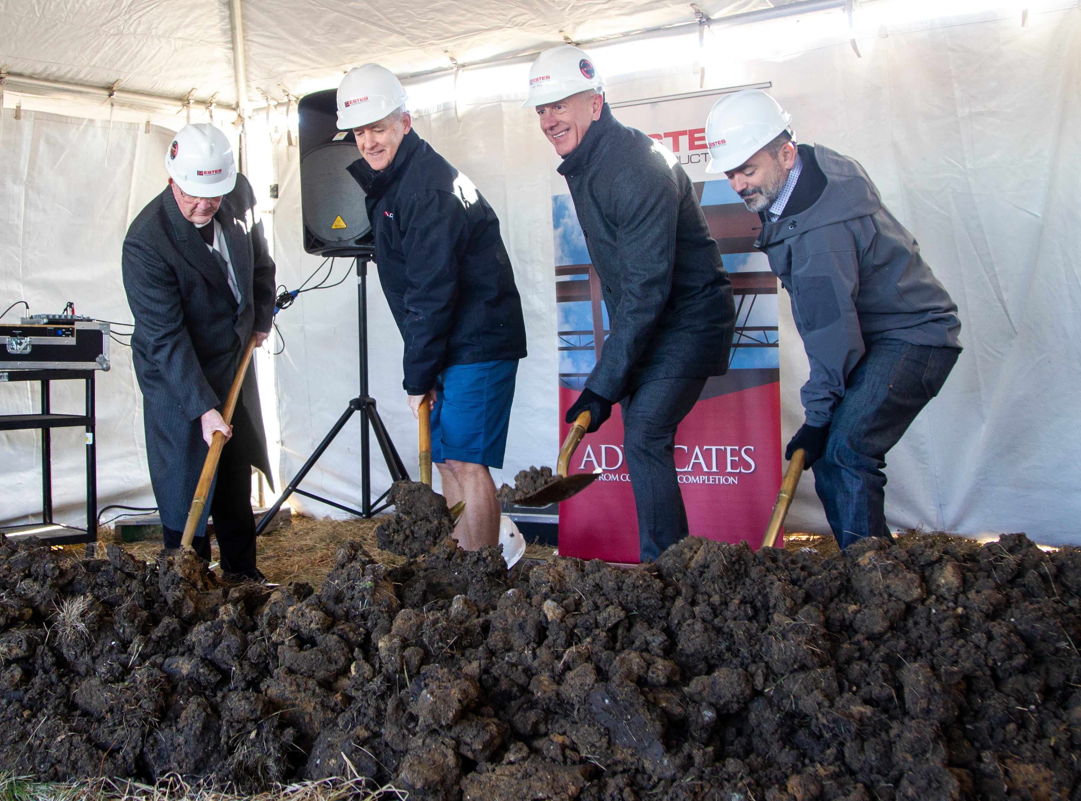 North Liberty Mayor Terry Donahue, from left, Diventures founder Dean Hollis, Estes Construction contractor Kent Pilcher, and H Design Group architect Rob Haik lift gold painted shovels of dirt during a groundbreaking event for a new Diventures store location on Thursday, Jan. 3, 2019, at the 1895 West Penn Street in North Liberty, Iowa.