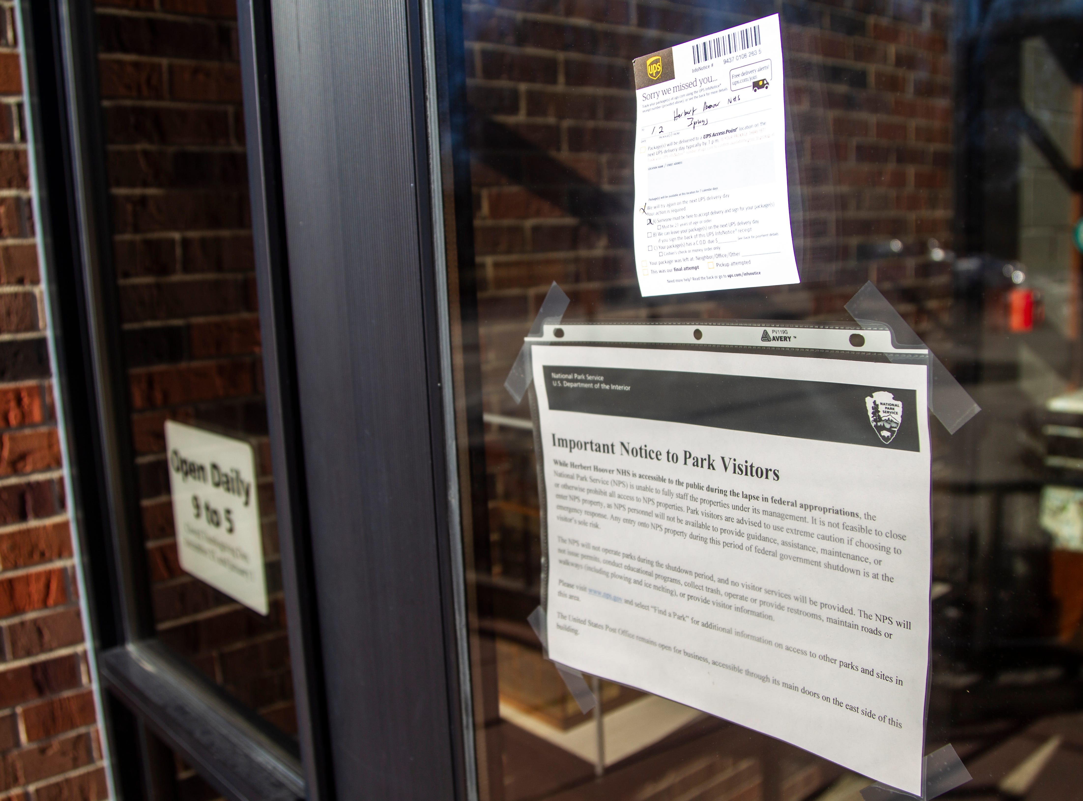 A notice from the National Parks Service is posted on a door to the visitor center about the government shutdown on Thursday, Jan. 3, 2019, at the Herbert Hoover National Historic Site in West Branch, Iowa.