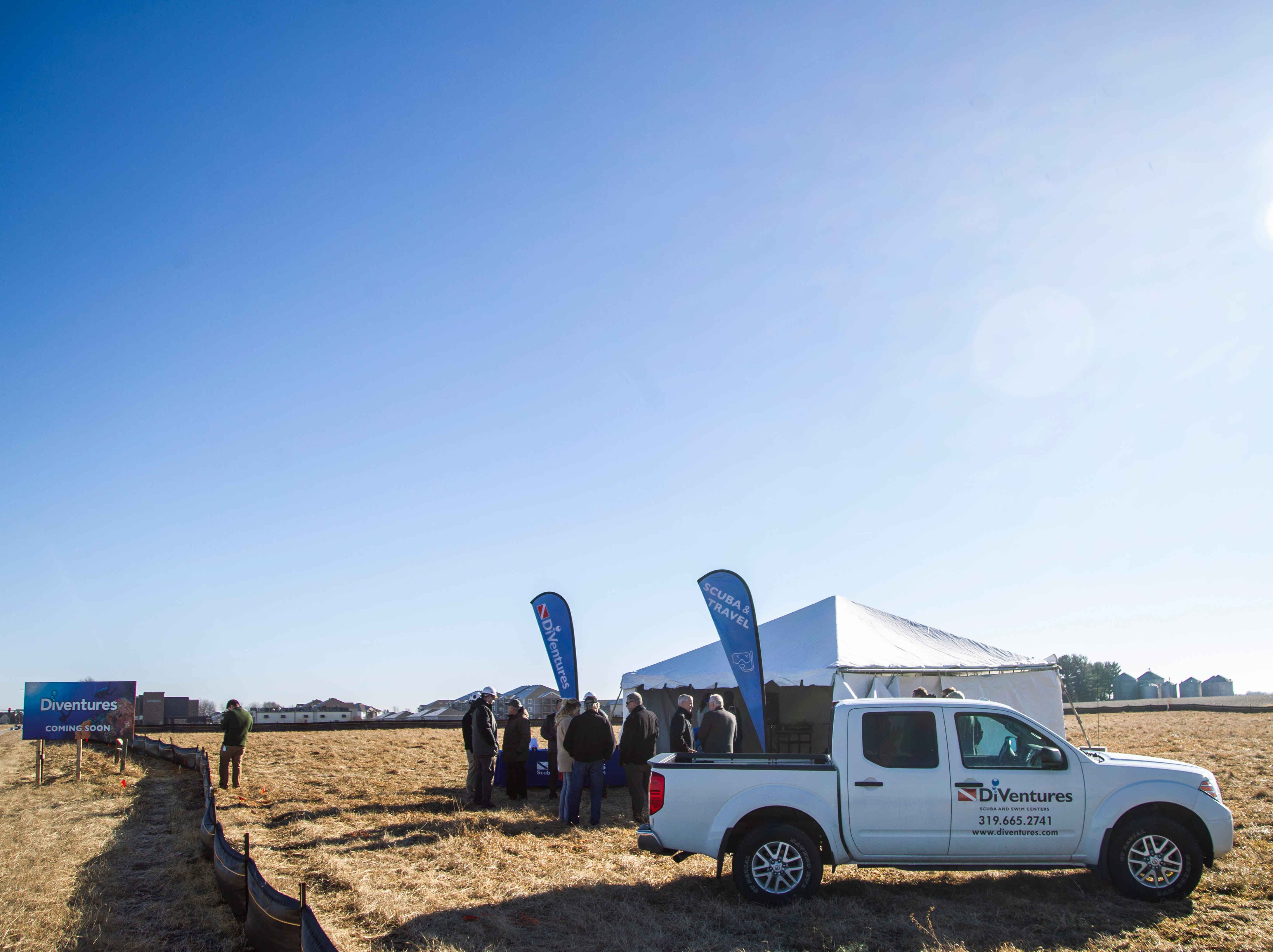 A Diventures vehicle is parked next to a tent before a groundbreaking event for a new Diventures store location on Thursday, Jan. 3, 2019, at the 1895 West Penn Street in North Liberty, Iowa.