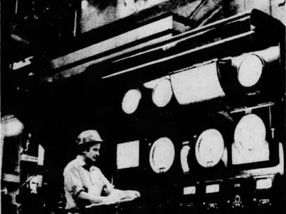 In this December 1973 file photo, a coal-fired boiler looms behind Howard Berry as he takes readings from the boiler's control panel.