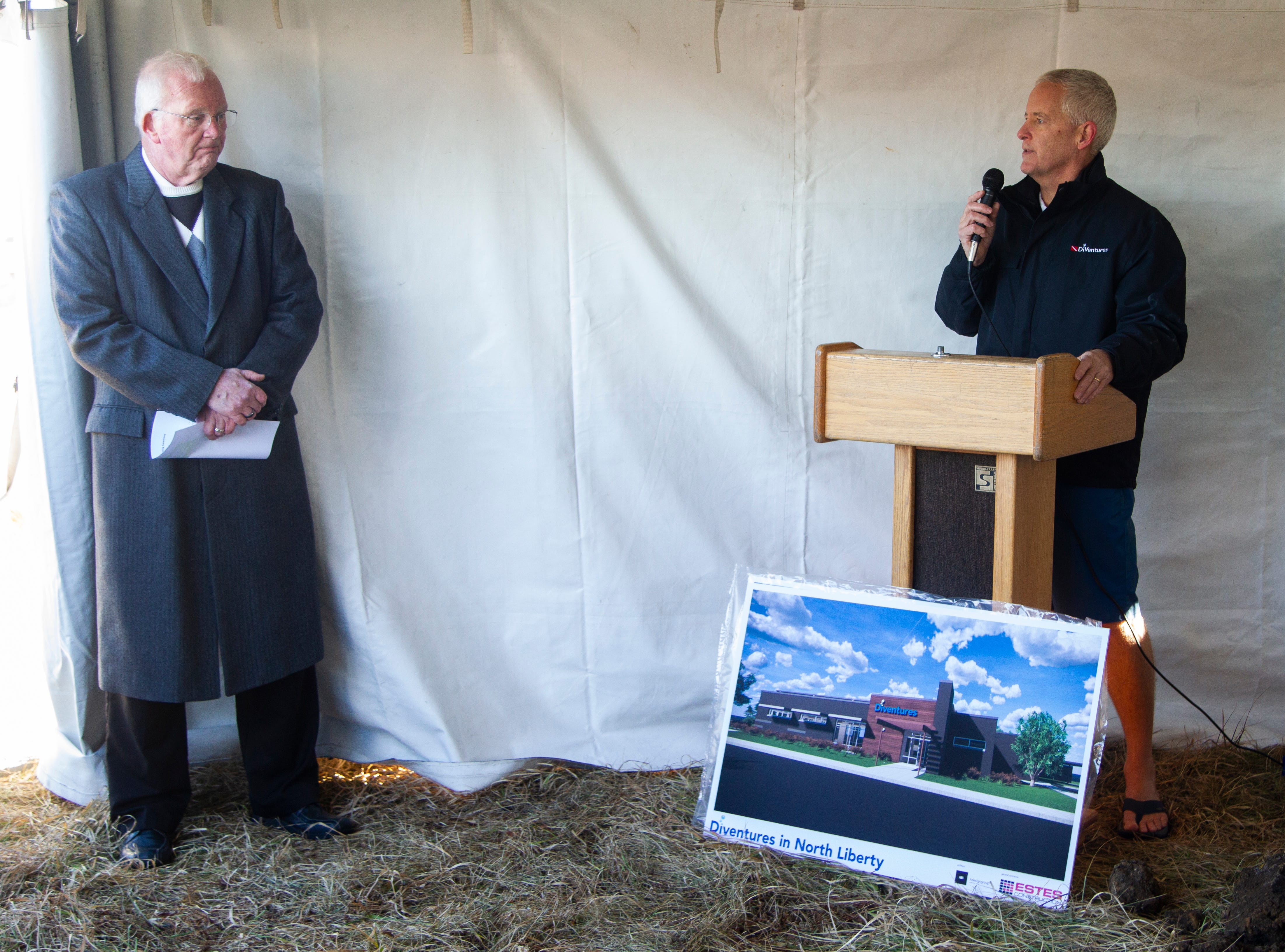 North Liberty Mayor Terry Donahue listens to Diventures founder Dean Hollis speak during a groundbreaking event for a new Diventures store location on Thursday, Jan. 3, 2019, at the 1895 West Penn Street in North Liberty, Iowa.